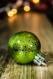 Green Christmas Ornament on Wooden Background Stock Images