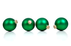 Green christmas ornaments/baubles on White Royalty Free Stock Photo