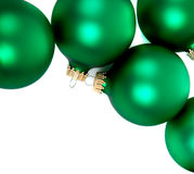 Green christmas ornaments/baubles on White Stock Photography