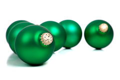 Green Christmas ornaments/baubles on white Royalty Free Stock Photos