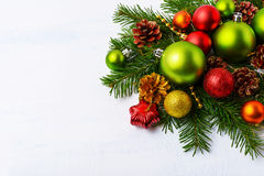Green Christmas ornaments, fir branches, red star and baubles Royalty Free Stock Image