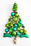 Green christmas ornaments in a tree shape Royalty Free Stock Photography