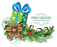 Green Christmas present with bow and fir branch Royalty Free Stock Images