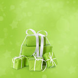 Green christmas presents isolated on green background. Stock Photography