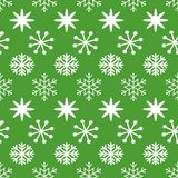 Green Christmas seamless pattern with swhite snowflakes. Green Christmas seamless pattern with cute white snowflakes. New Year background for wallpaper, fabric Royalty Free Stock Images