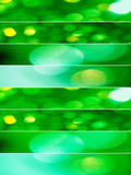 Green Christmas sparkling lights backgrounds. Vertical composition divided in eight horizontal lines with abstract sparkling textures in green tones Stock Photos