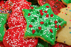 Green Christmas Star. Beautifully decorated red, white, and green star-shaped Christmas cookie stock photo