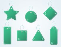 Green christmas tag collection with snowflakes and hangers. Sale promotion and gift card illustrations. Green christmas tag collection with snowflakes and Royalty Free Stock Photography
