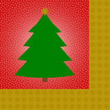 Green christmas tee on red Royalty Free Stock Photo