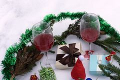 Green Christmas tinsel, Christmas tree balls, cones and wine . The view from the top. royalty free stock photography