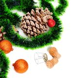 Green Christmas tinsel, Christmas-tree balls, pine cone and cham Stock Images