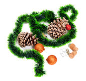 Green Christmas tinsel, Christmas-tree balls, pine cones and cha Stock Photos
