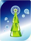 Green Christmas tree on abstract blue background. Royalty Free Stock Photos