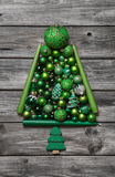 Green christmas tree of balls decorated on wooden background. Stock Photos