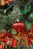 Green Christmas tree color lights red ball ornament Stock Photography