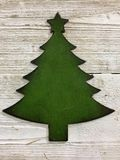 Green Christmas tree cut out. Background Royalty Free Stock Images