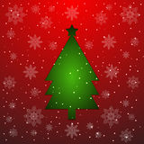 Green Christmas tree cut from paper on red Stock Image