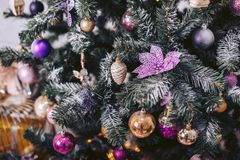 Green Christmas tree decorated with toys. Green Christmas tree with colorful toys Royalty Free Stock Photography