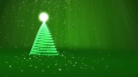 Green Christmas tree from glow shiny particles on the left. Winter theme for Xmas or New Year background with copy space. Christmas tree from glow shiny stock footage