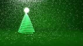 Green Christmas tree from glow shiny particles on the left. Winter theme for Xmas or New Year background with copy space. Christmas tree from glow shiny stock video footage