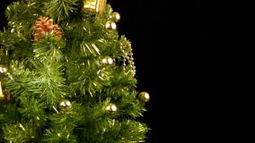 Green Christmas tree with gold ornaments rotate stock video footage