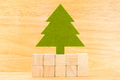Green christmas tree on group of wood cube block in wooden room,Mock up for adding your text on cube block, christmas holiday con royalty free stock photography
