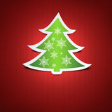 Green Christmas tree on red background Royalty Free Stock Image