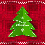 Green Christmas tree on red knitted background Royalty Free Stock Photo