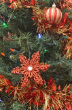 Green Christmas tree red ornaments, lights, decorations Royalty Free Stock Image