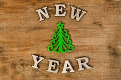 Green Christmas tree and sign New year from wooden letter. S, symbol of wooden texture background. Happy new year 2018 backdrop. New year.Greeting card royalty free stock image