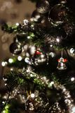 Green Christmas Tree With Silver Bells in Bokeh Photography stock photos
