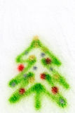 Green christmas tree, sprayed in the snow Royalty Free Stock Image
