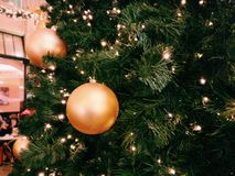 Green Christmas Tree With Three Round Gold Ornaments Stock Image
