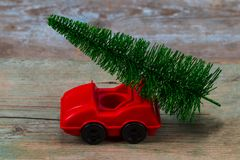 Green Christmas tree on toy car. Christmas holiday celebration c. Oncept stock photography