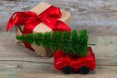 Green Christmas tree on toy car and gift. Christmas holiday celebration concept.  royalty free stock photo