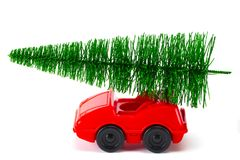 Green Christmas tree on toy car. Christmas holiday celebration c. Oncept royalty free stock image