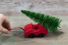Green Christmas tree on toy car. Christmas holiday celebration c. Oncept royalty free stock photo