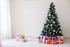 Green Christmas tree with toys new year winter gifts decor royalty free stock images