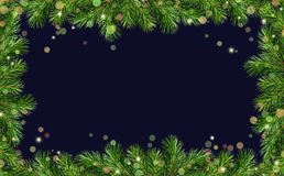 Green Christmas tree twigs borders and holiday lights. On dark blue background. Top view. Christmas frame royalty free stock image