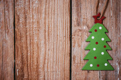 Green christmas tree on wood background, greeting card template, wallpaper, vintage Stock Photos