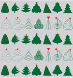 Green Christmas Trees. Over silver background with red ornaments Royalty Free Stock Photos