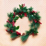 Green Christmas Wreath on Beige Wooden Vintage royalty free stock photos