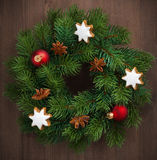 Green Christmas wreath with cookies and decorations, close-up royalty free stock photos