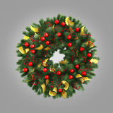 Green christmas wreath with decorations isolated on gray background Stock Image