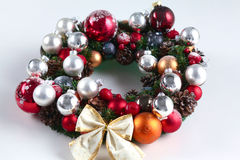 Green christmas wreath with decorations isolated Royalty Free Stock Images