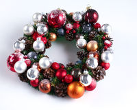 Green christmas wreath with decorations isolated Royalty Free Stock Image