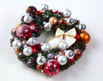 Green christmas wreath with decorations isolated Stock Photography