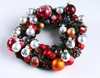 Green christmas wreath with decorations isolated Royalty Free Stock Photo