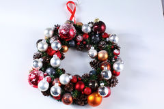 Green christmas wreath with decorations isolated Royalty Free Stock Photos