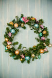 Green christmas wreath with decorations isolated on white background Stock Photo